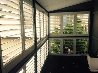 white aluminim shutters holland park